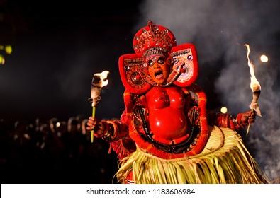 Thiruvanathapuram, Kerala, India- February  27 2017: A Theyyam Artist performing with fire.
