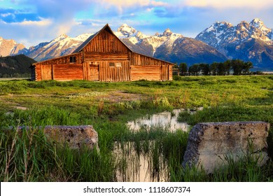 This abandoned barn in Jackson Hole, Wyoming is part of Mormon row and sits at the base of the Grand Teton snow capped mountains.  this landmark is on the National Register of Historic places.