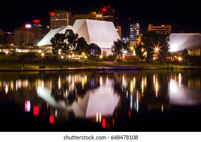 This is the Adelaide Festival Centre in South Australia reflected in the waters of the River Torrens at night.