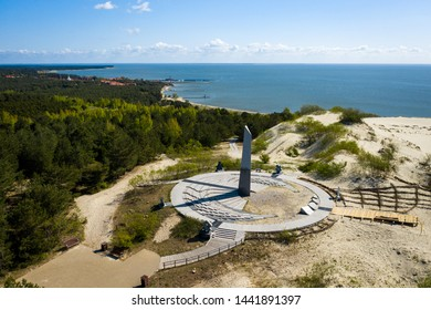 This is an aerial drone view of huge outdoor sundial clock standing on the Parnidis dune near Nida city in Curonian Spit, Lithuania.