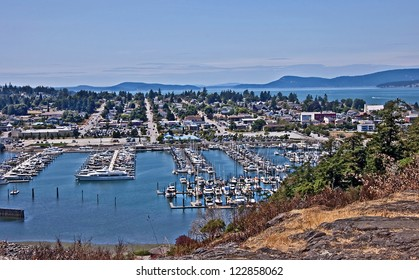 This is an aerial landscape of Anacortes Washington, overlooking the marina.  Puget Sound and the San Juan Islands are in the distance. Small coastal town in Skagit County, Washington state.