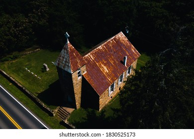 This is an aerial view of the abandoned Rising Zion Baptist Church and adjoining cemetery in rural Virginia.