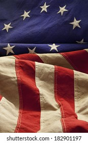This American flag, popularly attributed to Betsy Ross, was designed during the American Revolutionary War features 13 stars to represent the original 13 colonies.