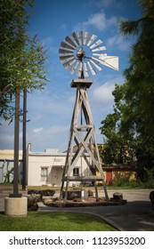 this antique windmill is on display in the parking lot