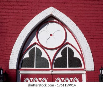 This architectural structure is found above a large door of the building. It has round and triangular shapes. Acton Vale, Quebec, Canada; October 19, 2018.