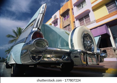This is the art deco district with a 1957 Chevrolet parked in front of a building. This area is also known as SOBE which stands for South Beach Miami.