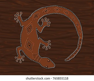 This  artwork depicts australian style dot painting of a brown gecko lizard on a dark brown background .