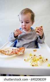 this baby has pizza and pop corn