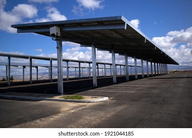 This bank of solar cells provides shade for the parking lot while producing power for the adjacent buildings.