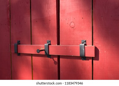 This barn door is locked with a sliding bar.