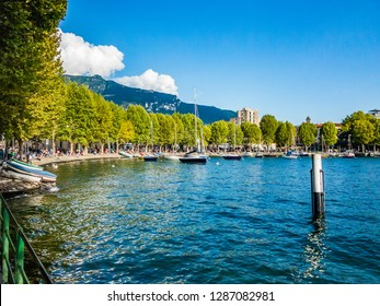 This is the Bay of the city of Lecco where we can see some boats at anchor and where you see the road along the Lake with the walk and the tree-lined Avenue.