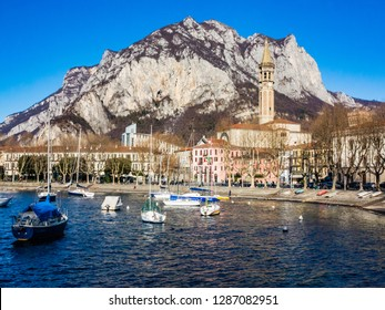 This is the Bay of the city of Lecco in winter where we can see some boats at anchor and where you see the road along the Lake with the walk and the tree-lined Avenue.