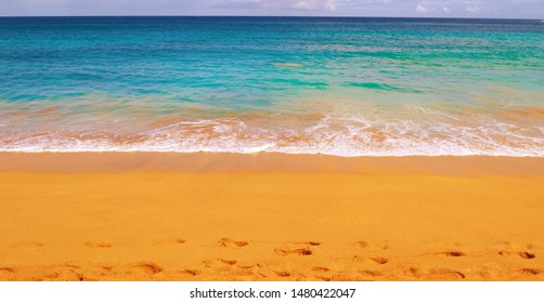 This beautiful beach scene was taken in Hawaii on the Island of Kauai. I was with my wife on my honeymoon and I was able  to capture this beautiful scene. The water was deep blue.
