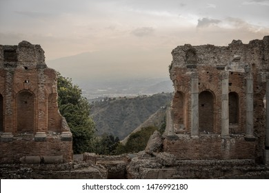 This beautiful picture was taken in the beautiful amphitheater in Taormina, Italy. Beautiful old colums making the picture.