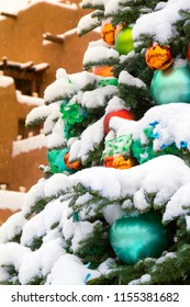 This beautiful snow covered Christmas Tree in Santa Fe New Mexico reflects the Holiday Season of the Southwest.