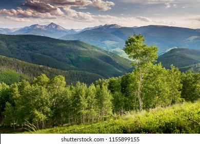 This beautiful view of a summer sunset from the summit of Vail Ski Mountain in Colorado illustrates the majestic scenery you'll find in this popular vacation destination.