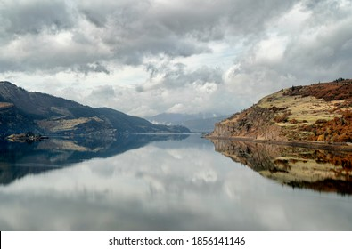 This is the Bingen Gap in the Columbia River in the Columbia Gorge, between Oregon and Washington.  It was taken in Autumn during  rare windless afternoon.