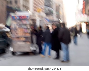 This is a blur shot of people waiting on line for the morning coffee wagon.