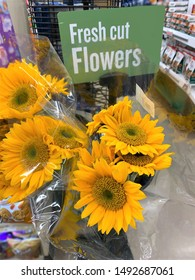 This is a bouquet of sunflowers for sale in a grocery store