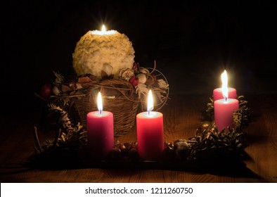 In this bright waiting for Christmas time, we light up four candles.  . Four candles symbolize four Advent weeks. The fifth candle symbolizes the Virgin Mary, the mother of Jesus Christ.