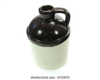 This is a brown and tan antique moonshine style jug.