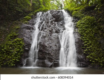 This is Brushbox Falls hidden away in a remote corner of the Border Ranges National Park. Waterfall cascades over rocks in thick jungle rain-forest.