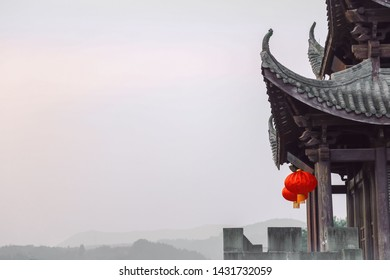 This building is located in The AncientCity of Lang Zhong which is a famous ancient architectural cluster located in The southwest of China。Mainly brick and tile structure,red lanterns and trees。