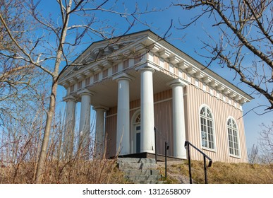 This building  style is called Eko Temple and this one  lies in Strangnas in Sweden, it was built in 1819