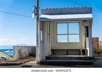 """this bus stop called Masase located in Hayama - cho Kanagawa Prefecture Japan. The nameplate of the bus stop has the bus destination """"Zushi station bound for"""" and the bus stop name """"Masase"""" writ."""