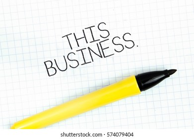 THIS BUSINESS concept write text on notebook
