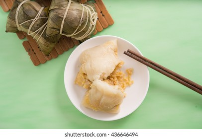 This can be used as background of food on Dragon Boat's Festival. Rice Dumplings are a kind of traditional food in China which is made of glutinous rice and other food materiel.