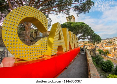 This is a Cannes text on top of a mountain in Cannes, it is a sign of this city. Cannes is a famous place in French because it is the place to do the film festival every years.