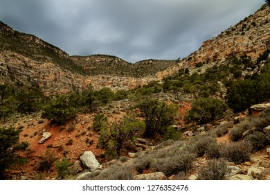 This is a canyon view found along the remote Boucher Trail in the s rim of the Grand Canyon NP in Arizona. The storm has arrived. Sloped cliffs are a normal feature in this area.