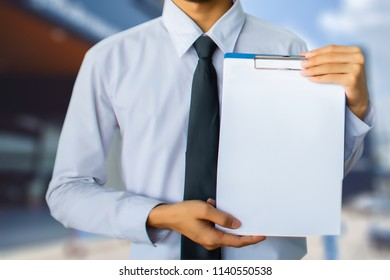 This career man saleman business inspection writing note on notepad or