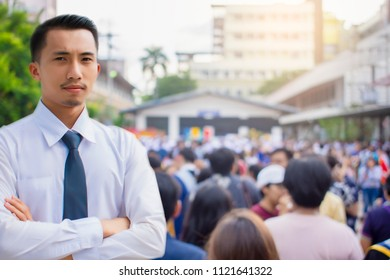 This career saleman or business man inspection with building and crowded people in city blurry background.metaphor business success copy space for advertising image
