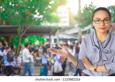 This career saleman or business woman inspection with building and crowded people in city blurry background.metaphor business success copy space for advertising image