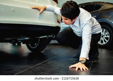 This career saleman inspection suspension car or Under the car to test the quality for customer metaphor for automobile automotive or transport advertising image