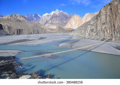 This is Cathedral Ridge viewed from the Karakoram Highway near the village of  Hussaini, Upper Hunza valley, Gilgit-Baltistan Pakistan with the suspension bridge foreground.