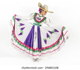 This charming dancer is wearing a picturesque dress used in the state of Aguascalientes in Mexico. She joins fiesta and rodeo events with other dancers as part of the folk culture.