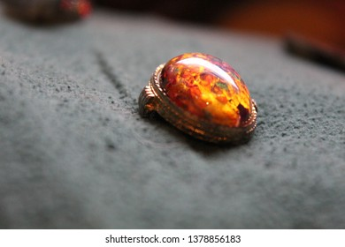 This is a close up of a fire opal locket