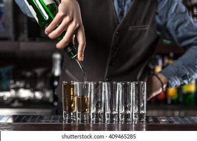 This is a closeup of barman making a cocktails.