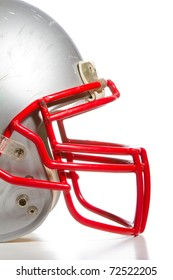 This is a close-up, side view of an old beat up football helmet. Shot on an isolated white background.