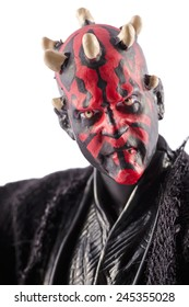 This is a Darth Maul action figure. This Star Wars movie character made by Hasbro. / Darth Maul portrait / Komarom, Hungary - 6th December 2014
