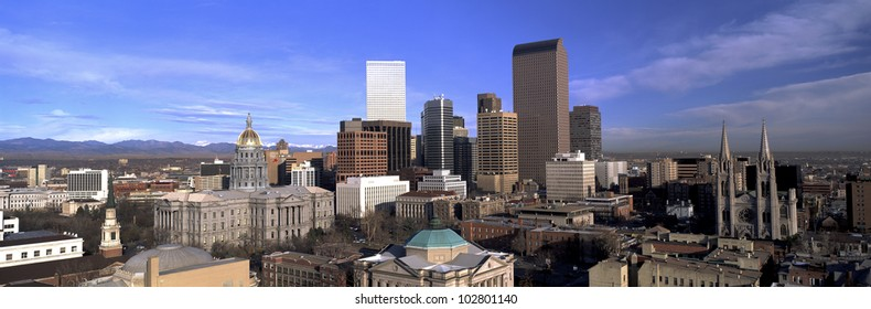 This is the Denver skyline, State Capitol and Rocky Mountains. It shows morning light on what is known as the Mile High City.