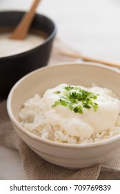 "This is a dish consisting of steamed rice topped with grated ""nagaimo (long taro)"" and ""yamaimo (Japanese mountain yam)""."