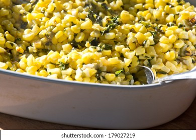 This dish contains corn and kale fried in butter.