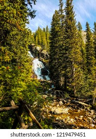 This is a distant view of one of the cascades of Hidden Falls located on the Lower Cascade Canyon Trail in the Jenny Lake area of Grand Teton National Park in Wyoming.