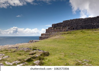 This is the east side of the inner enclosure wall of Dun Aonghasa (Dun Aengus) where it ends at a cliff edge over the Atlantic ocean.  Inishmore, the Aran Islands, County Galway, Ireland.