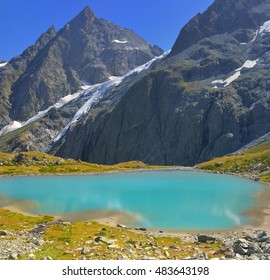 This is emerald lake in Caucasus mountains in autumn