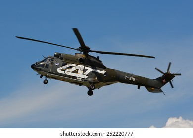 This is the Eurocopter AS 332 M1 Super Puma T-316 from the Swiss Air Force. Here we can see it at the air14 show in Payerne Switzerland on the 30th of August 2014.